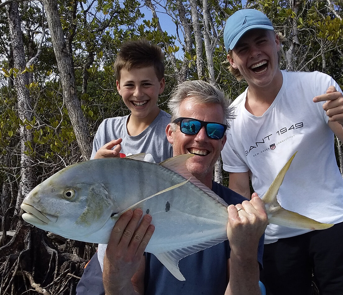 Father and sons fishing on the Daintree River