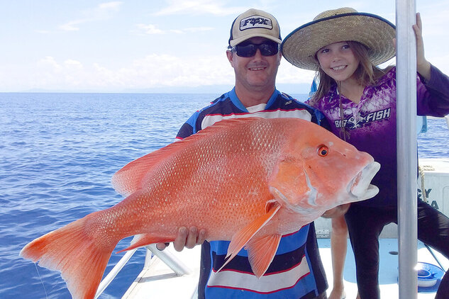 People showing off their Red emperor fish catch